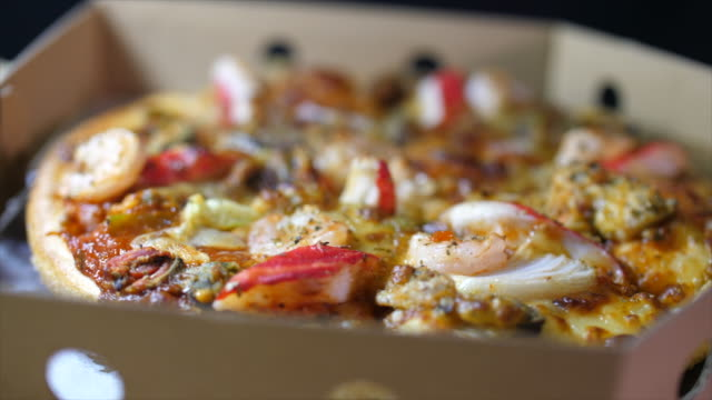 close-up sea food pizza slice in box, rotating shot in studio - meal box stock videos & royalty-free footage