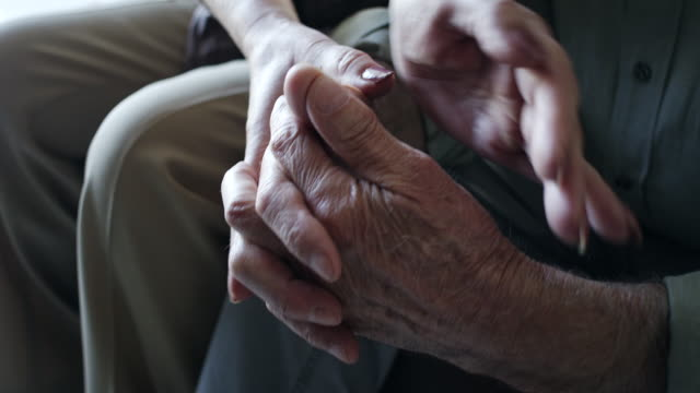 Close-up, senior couple holding hands
