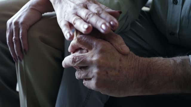 Close-up, senior couple holding hands