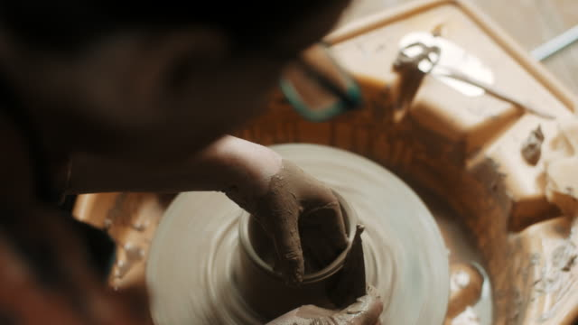 close-up, senior woman using pottery wheel at atelier - pottery stock videos & royalty-free footage