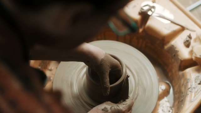 close-up, senior woman using pottery wheel at atelier - potter's wheel stock videos & royalty-free footage