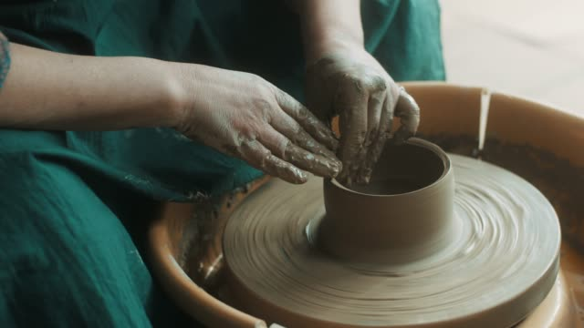 close-up, senior woman using pottery wheel - potter stock videos & royalty-free footage