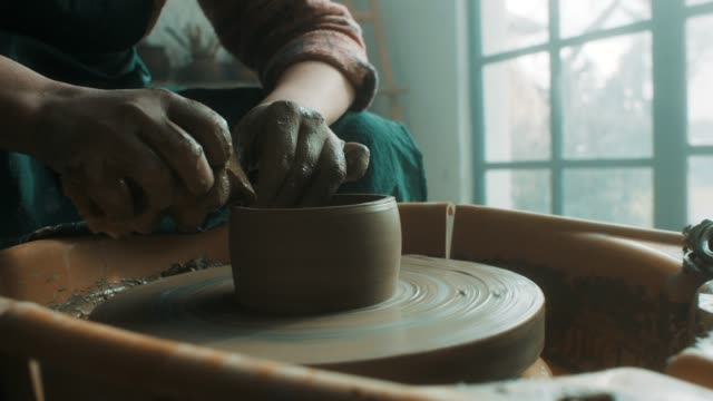 close-up, senior woman using pottery wheel - ceramics stock videos & royalty-free footage
