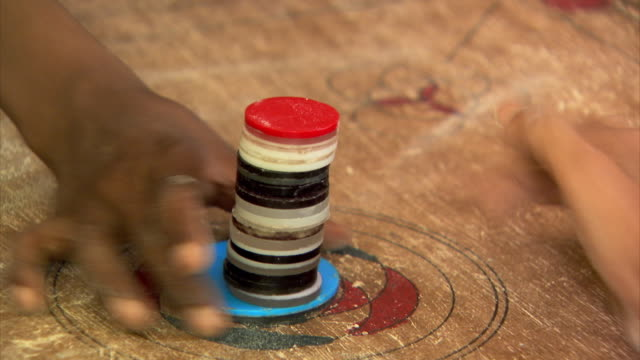 close-up sequence of the board game carrom (also known as karrom) being played by children in dhaka, bangladesh. - carrom stock videos & royalty-free footage