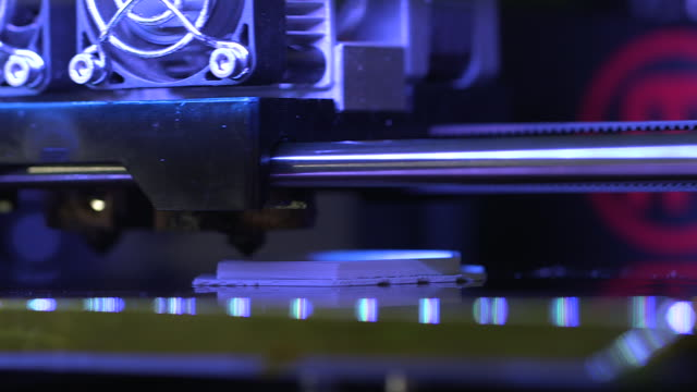 close-up sequence showing a 3d printer printing a bowl based on a hexagonal shape, uk. - 3d printing stock videos and b-roll footage