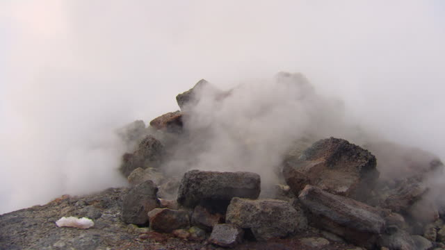close-up sequence showing billowing steam rising from a fumarole in iceland. - smoke physical structure stock videos & royalty-free footage