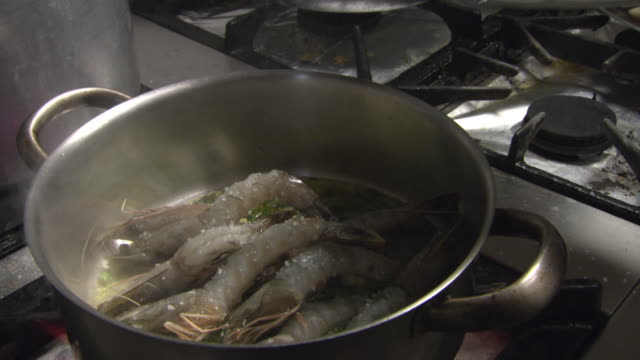 close-up sequence showing the cooking of a prawn and clam dish at a restaurant in portugal. - portuguese culture stock videos & royalty-free footage