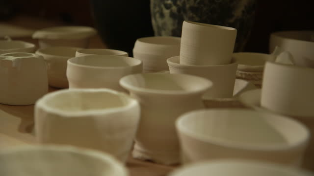 close-up sequence showing undecorated bowls on a tabletop, uk. - pottery stock videos & royalty-free footage