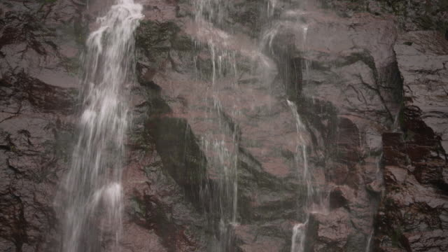 Close-up sequence showing water cascading down rocks in the Catskill Mountains, New York State, USA.