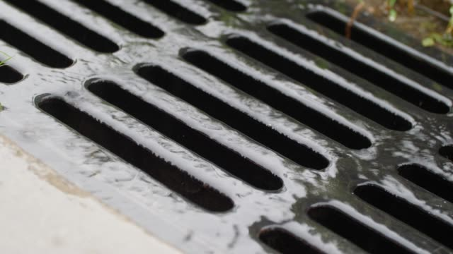 close-up sewer in rain day - drainage stock videos & royalty-free footage