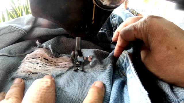 close-up, sewing, repairing jeans with old machines. - sewing stock videos & royalty-free footage