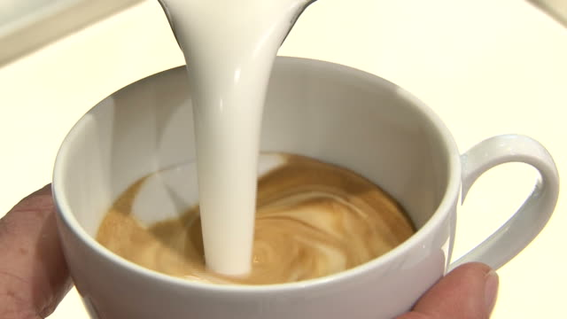 close-up shot coffee cup being made by barista - soap sud stock videos & royalty-free footage