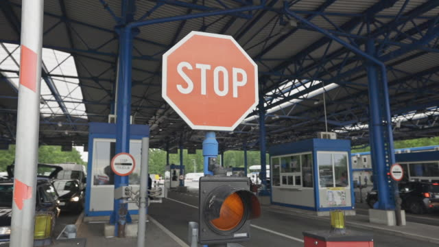 close-up shot of a barrier of stop sign at the border crossing stock video - border stock videos & royalty-free footage