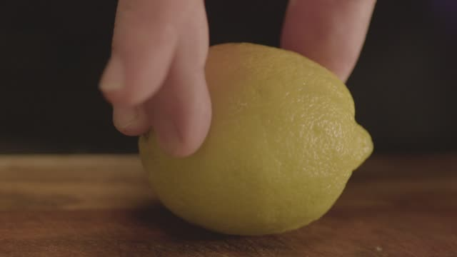 close-up shot of a bartender cutting a lemon in two - sour taste stock videos & royalty-free footage