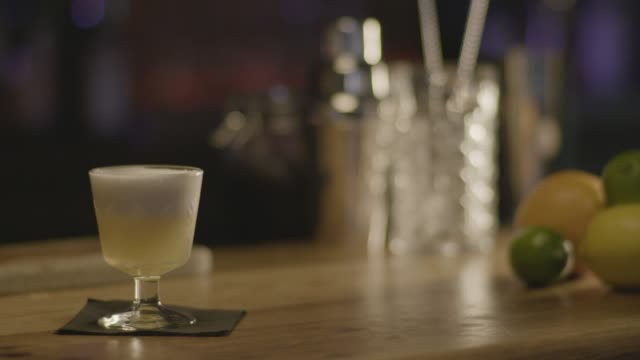 close-up shot of a bartender serving a classic whiskey sour cocktail - napkin stock videos & royalty-free footage