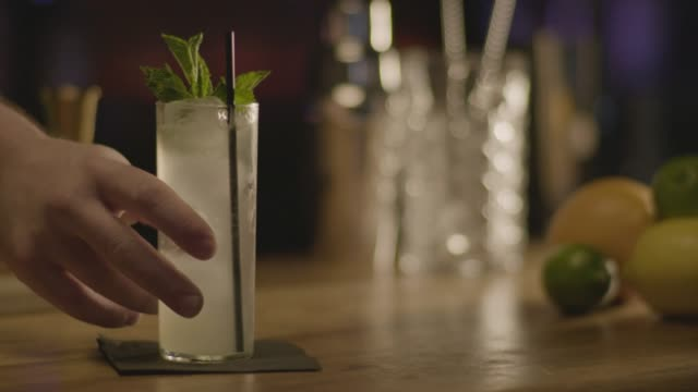close-up shot of a bartender serving a gin rickey cocktail - napkin stock videos & royalty-free footage