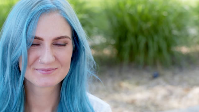 close-up shot of a beautiful unique spunky fashionable young woman with fun cute teal blue green dyed hair standing posing outdoors in the summer with copy space - nose piercing stock videos & royalty-free footage