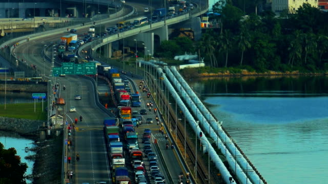 closeup shot of a busy traffic at the singapore causeway bridge - johor stock videos & royalty-free footage