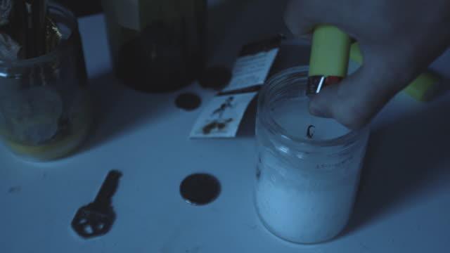 vídeos y material grabado en eventos de stock de closeup shot of a candle being lit at night - 4k - mesa baja de salón
