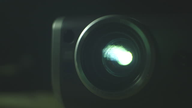 Close-up shot of a Canon projector lens in use.