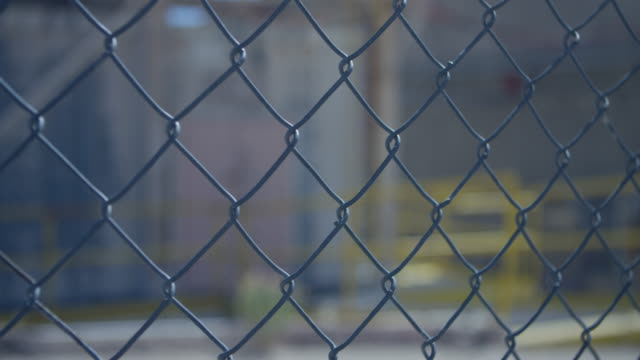 close-up shot of a chain-link fence at nevada test site - chainlink fence stock videos and b-roll footage