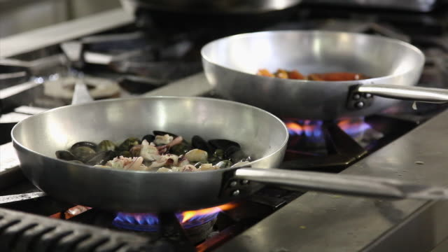close-up shot of a chef pouring hot water into seafood and lobster sauces - seafood stock videos & royalty-free footage