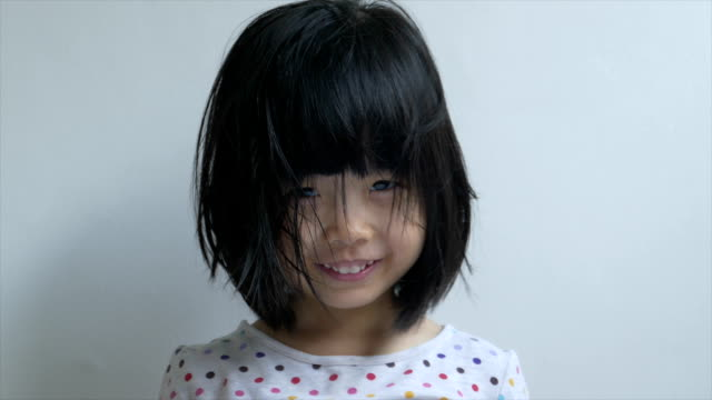 closeup shot of a chinese female toddler making faces - rufsig bildbanksvideor och videomaterial från bakom kulisserna