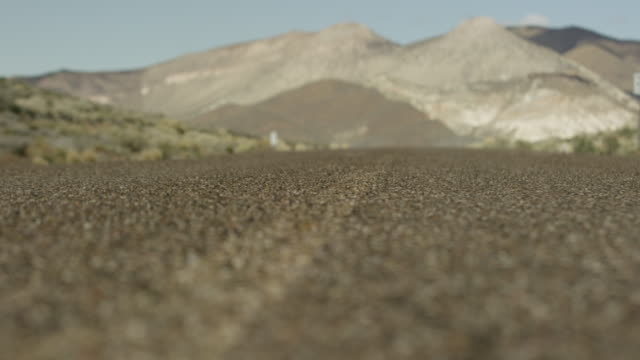 close-up shot of a concrete road at nevada test site - nevada stock-videos und b-roll-filmmaterial