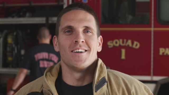 close-up shot of a fireman at the fire station - heroes stock videos & royalty-free footage