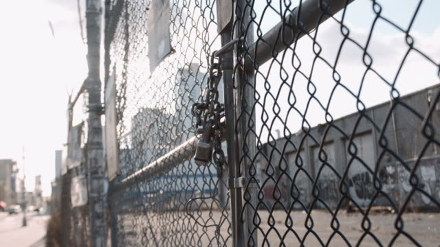 closeup shot of a locked gate - keep out sign stock videos & royalty-free footage