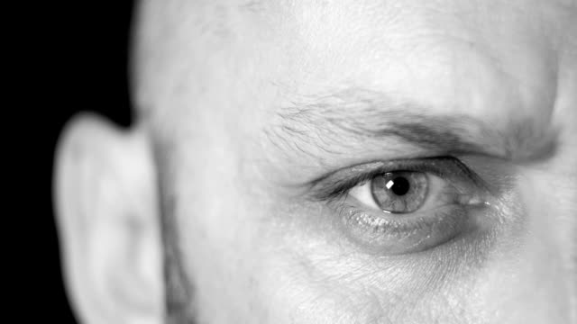 close-up shot of a man's eye - image focus technique stock videos & royalty-free footage