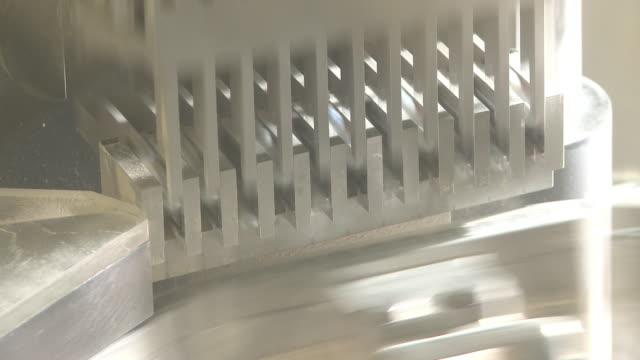 closeup shot of a metal stamping machine expelling capsules. - läkemedelsfabrik bildbanksvideor och videomaterial från bakom kulisserna