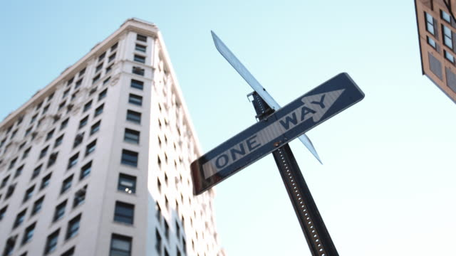closeup shot of a one way street sign in new york city - one way stock videos and b-roll footage