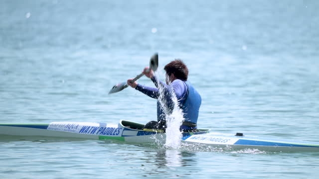 close-up shot of a paraplegic athlete racing his kayak during a paracanoe competition - active lifestyle stock videos & royalty-free footage