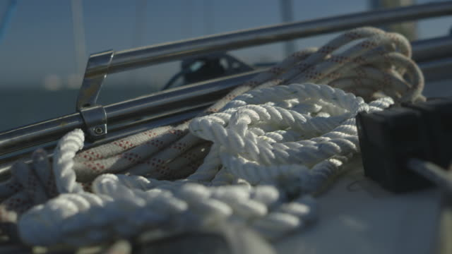 close-up shot of a pile of ropes on a moving yacht, uk. - rigging nautical stock videos & royalty-free footage
