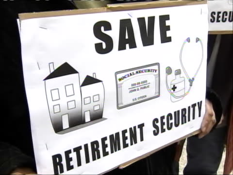 close-up shot of a senior holding a sign to promote retirement security at 'occupy chicago.' senior citizens gathered in the city to join the... - anonymous activist network stock videos & royalty-free footage