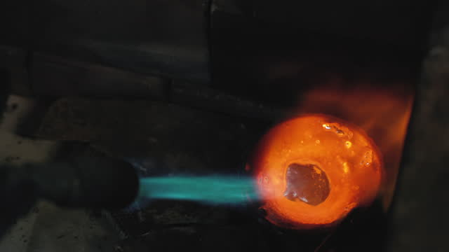 close-up shot of a silversmith melting silver in preparation for making jewellery - metallic stock videos & royalty-free footage
