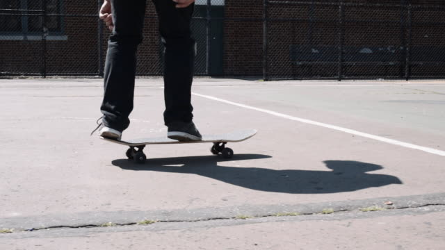 Closeup shot of a skateboard trick in slow motion
