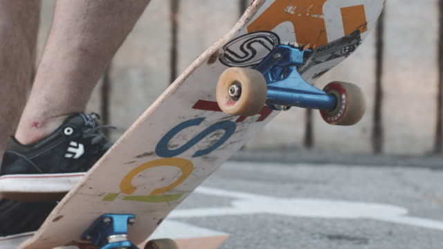 Closeup shot of a skateboarder in slow motion