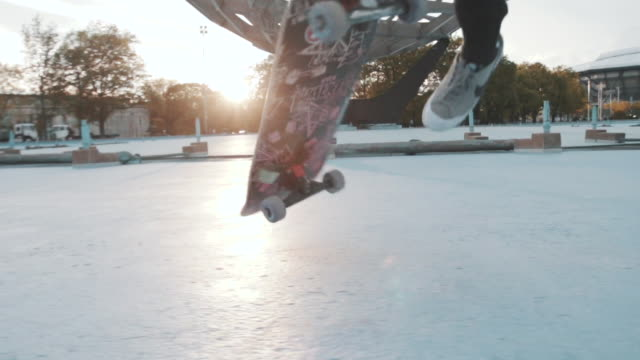 a closeup shot of a skateboarder's feet at sunset in slow motion. - exhilaration stock videos & royalty-free footage
