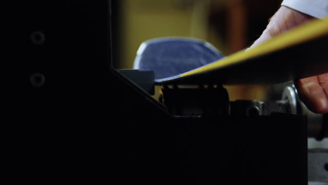 close-up shot of a ski technician using a belt grinder to sharpen the edges of downhill skis as sparks fly in an indoor repair shop - alpine skiing stock videos & royalty-free footage