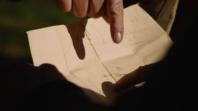 close-up shot of a strategic map being discussed by soldiers - gossip stock videos & royalty-free footage