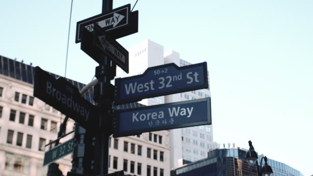Closeup shot of a street sign in Korea Town in New York City