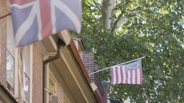 close-up shot of a union jack and a betsy ross flag waving in the elfreths alley street - philadelphia pennsylvania stock videos & royalty-free footage