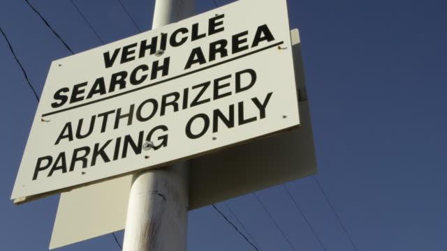 vidéos et rushes de close-up shot of a vehicle search area sign at nevada test site - arme de destruction massive