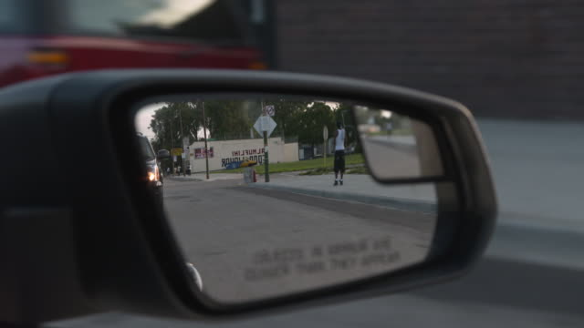 close-up shot of a wing mirror of a car driving through chicago's southern suburbs on south halsted street, illinois, usa. - wing mirror stock videos & royalty-free footage