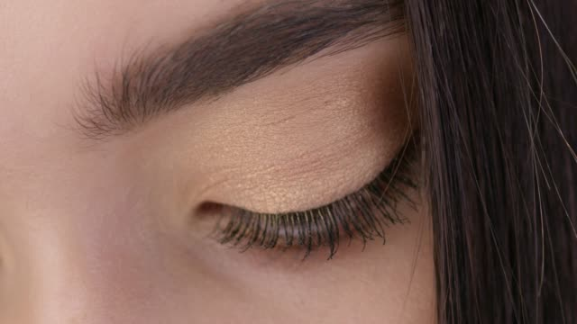 close-up shot of a woman opening her eyes with light day make-up. - eyebrow stock videos & royalty-free footage