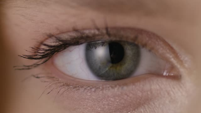 close-up shot of a woman opening her eyes with light day make-up - contracting stock videos & royalty-free footage