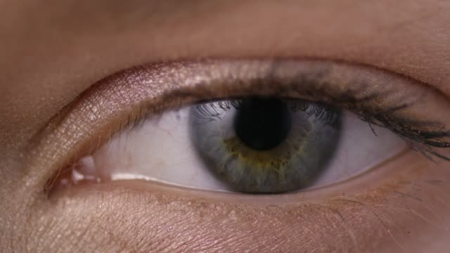 close-up shot of a woman opening her eyes with light day make-up - retina stock videos and b-roll footage