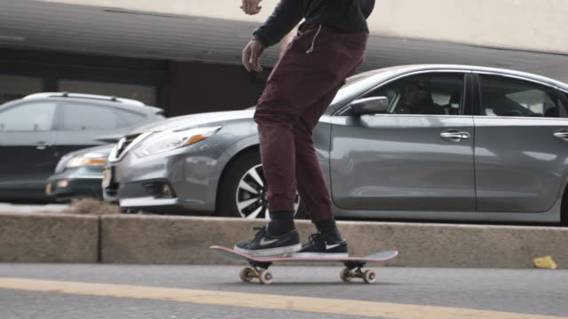 closeup shot of a young mixed race man skateboarding. - 20 29 years stock videos & royalty-free footage